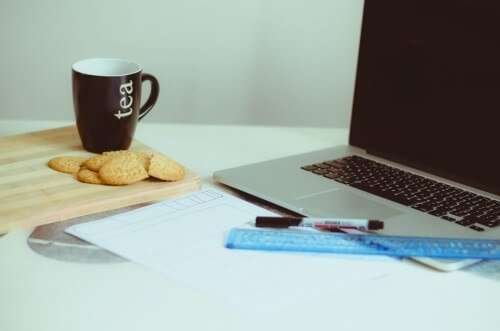 laptop coffee cup and crackers