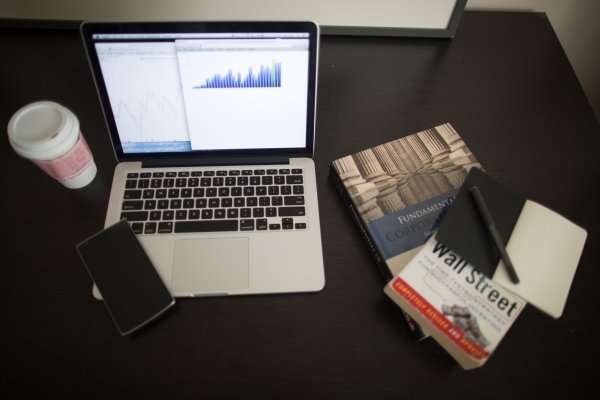 phone, laptop books and coffee cup