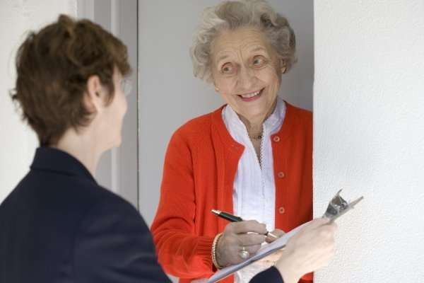 door to door canvasser with older woman