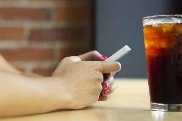 phone and a coke