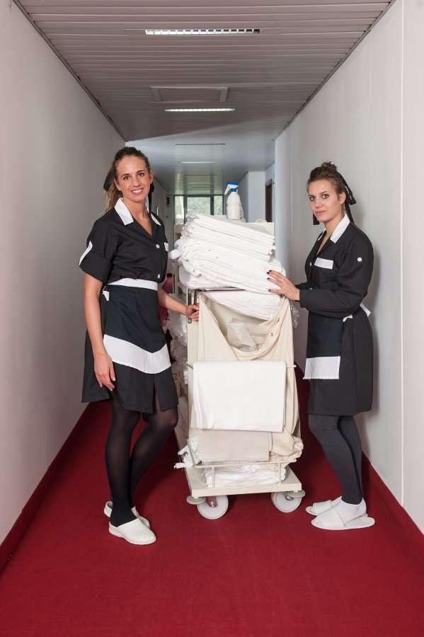 chambermaids in hotel hallway