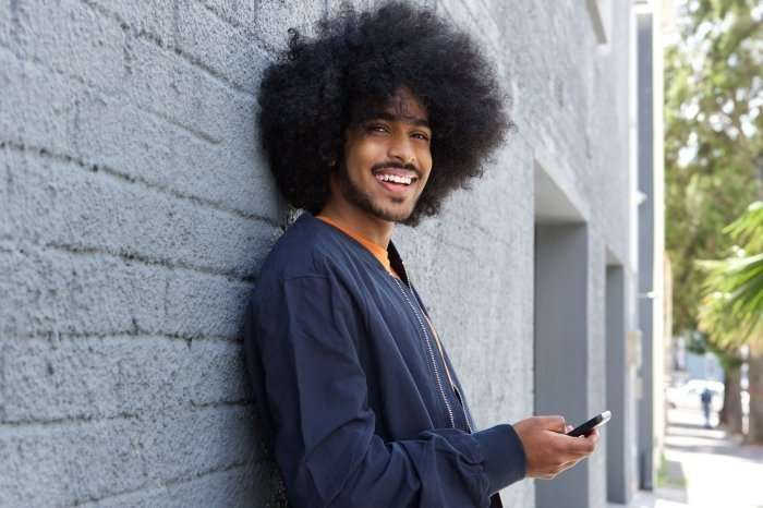 young man using his smartphone