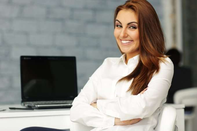 woman-smiling-with-laptop-2