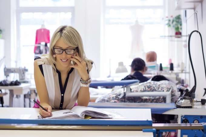 woman-on-the-phone-in-a-small-business