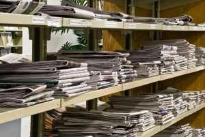 newspapers on a shelf