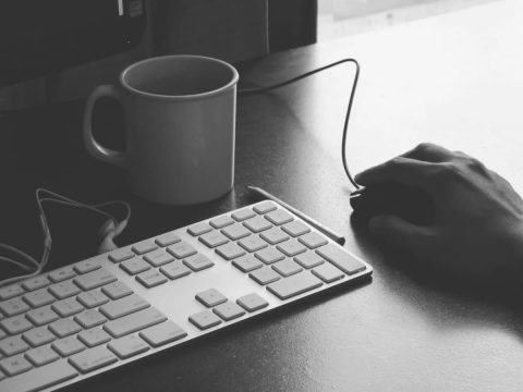 keyboard, coffee mug and mouse in black and white