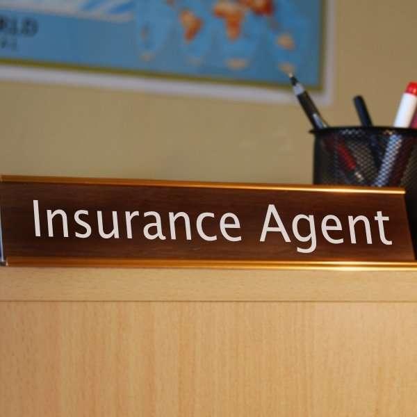 insurance agent desk sign