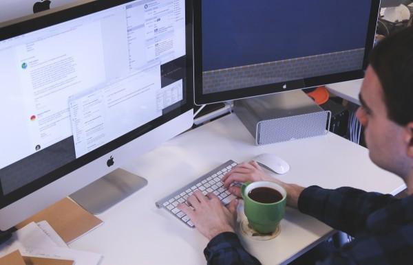 man working at computer monitor