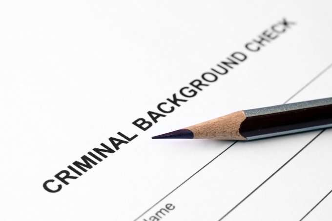 Criminal Background Check form and pencil
