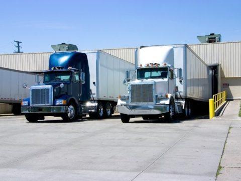 two 18 wheeler trucks