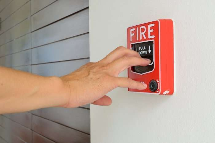 Pulling a fire alarm
