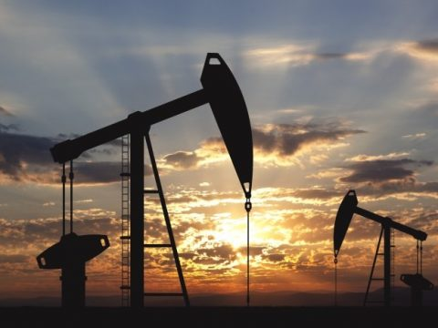 Oil well and sunset