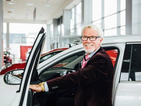 Smiling older driver at auto dealership
